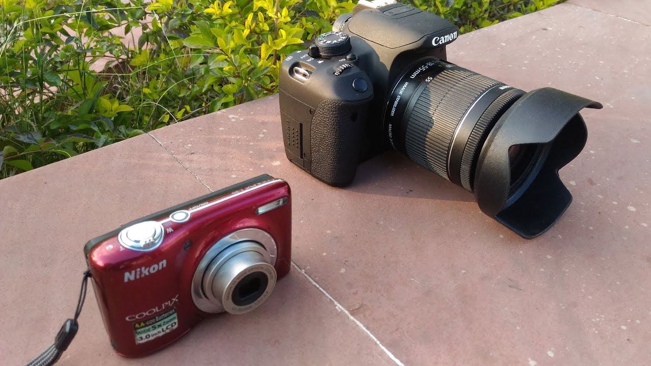 product photo of the point and shoot camera with DSLR camera on its right
