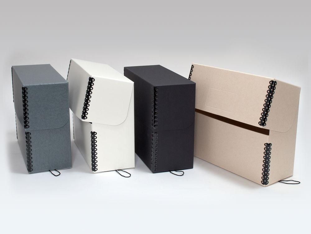 product photo of an upright photo storage box in four different colors