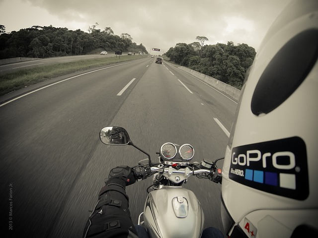 photo captured by a gopro camera on a gopro helmet mount attached on the left side of the helmet of a motorcycle rider