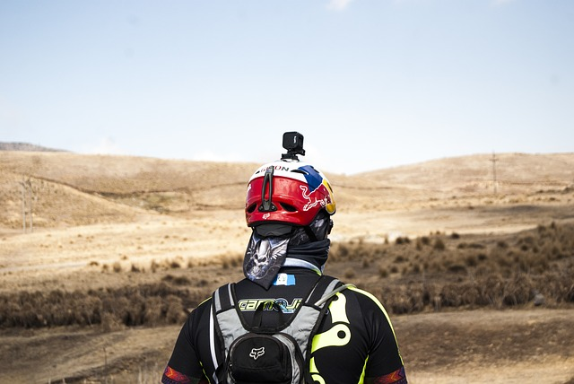 a hiker with a gopro mounted on top of his helmet