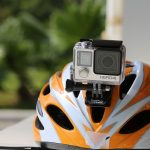 gopro attached to the gopro helmet mount on top of the head of a helmet